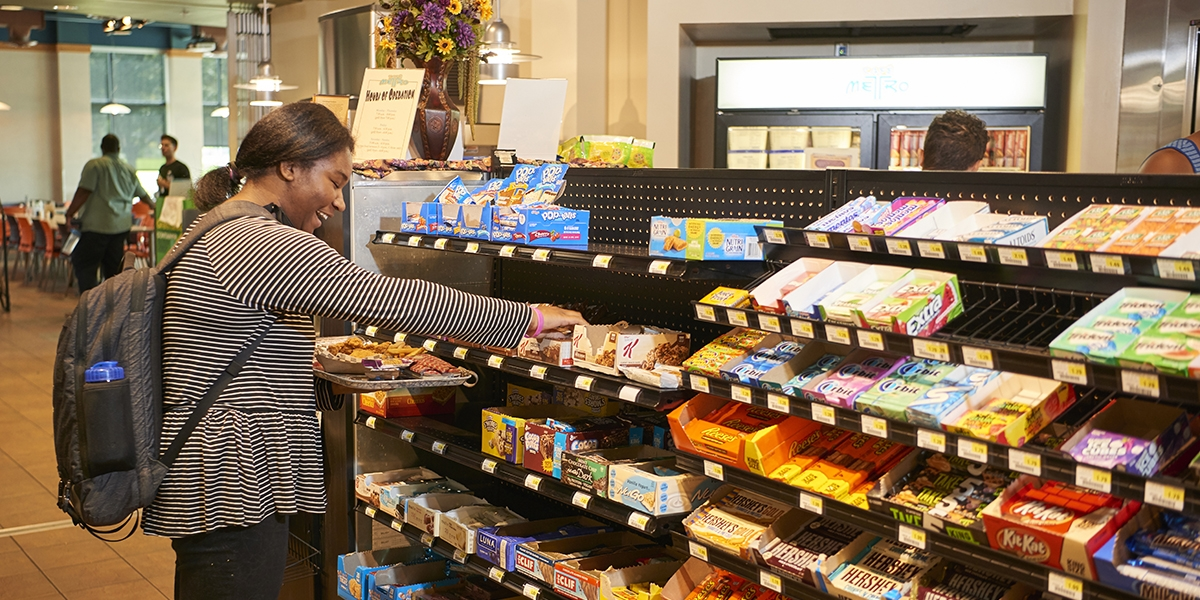 female student browsing retail options at Cafe Metro