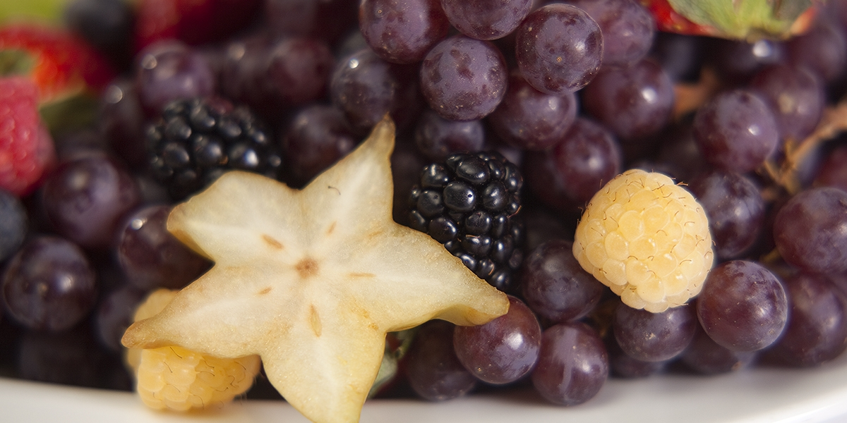fruit platter with grapes, strawberries, blackberries, and star fruit