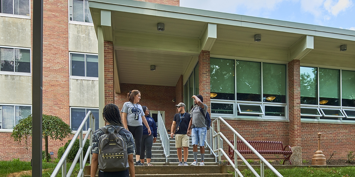 Students at the entrance to McKeesport Hall